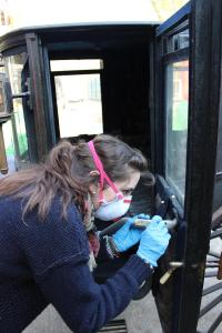 Cleaning the interior. The mask is worn to prevent us from breathing in anything nasty
