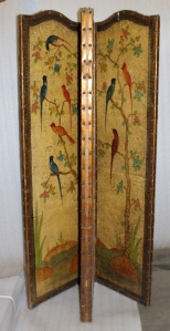 Screen decorated with exotic birds and flowers.