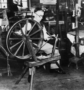 This image was taken between 1930-1949 and shows a worker at F. Hinde and sons factory spinning silk.
