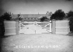 Heckingham union workhouse in around 1910. Also covered was the meeting of the Loddon and Clavering board of guardians, responsible for Heckingham workhouse. There were 75 inmates compared with 77 at the same time last year. They discussed the recent annual 'treat' that had been given to the inmates and recorded the inmate's gratitude for receiving it. The treats included lemons, oranges, tobacco and illustrated papers.