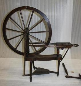 Shows a virtually identical spinning wheel that we hold in our collection and was in fact recently audited from one of the boxes.