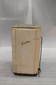 Single tub Hoover washing machine with a white finish and the make 'Hoover' in black on the front.  The machine is inscribed with ' By Appointment to H.M. King George VI / Manufacturers of Electric Suction Sweepers / The Hoover Trademark Electric Washing Machine / Patents applied for in all principal countries / made by Hoover Ltd. Great Britain'. Dates from about 1940.