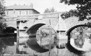 Bishop Bridge is the only medieval bridge left in Norwich, the first mention of is in 1331. This photograph was taken in 1968 and is a view of the South side of the river.