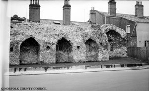 The section of the city walls in front of the Chapelfield Mall. At the time of this photograph (1957) the site behind the wall was home to the Mackintosh factory producing chocolate and confectionery.