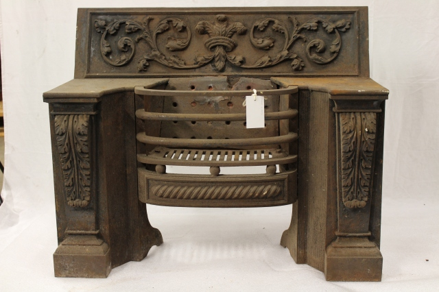 A typical fireplace from the 1850s with pillars decorated with acanthus leaves and Prince of Wales feathers in relief